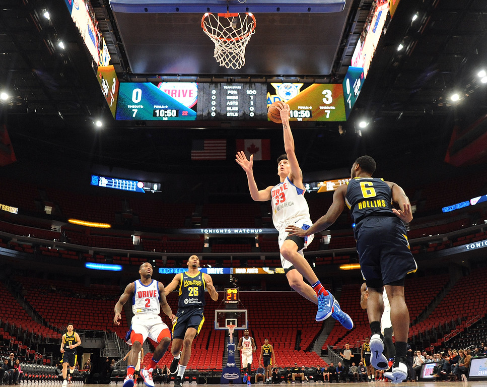 . Grand Rapids Drive forward Derek Willis (33) goes to the basket against the Fort Wayne Mad Ants, the D-League affiliate for the Indiana Pacers, Wednesday, Feb. 28, 2018 in Detroit.  The Mad Ants defeated the Drive, 115-104.  (Special to The Oakland Press/Jose Juarez)