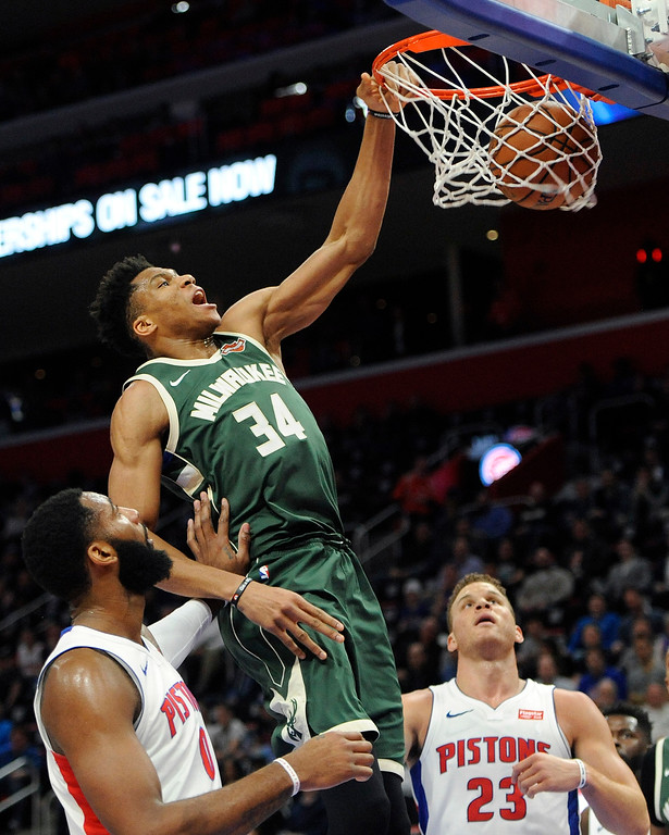 . Milwaukee Bucks forward Giannis Antetokounmpo (34) dunks against the Detroit Pistons in the first quarter of an NBA basketball game, Wednesday, Feb. 28, 2018 at Little Caesars Arena in Detroit.  (Special to The Oakland Press/Jose Juarez)