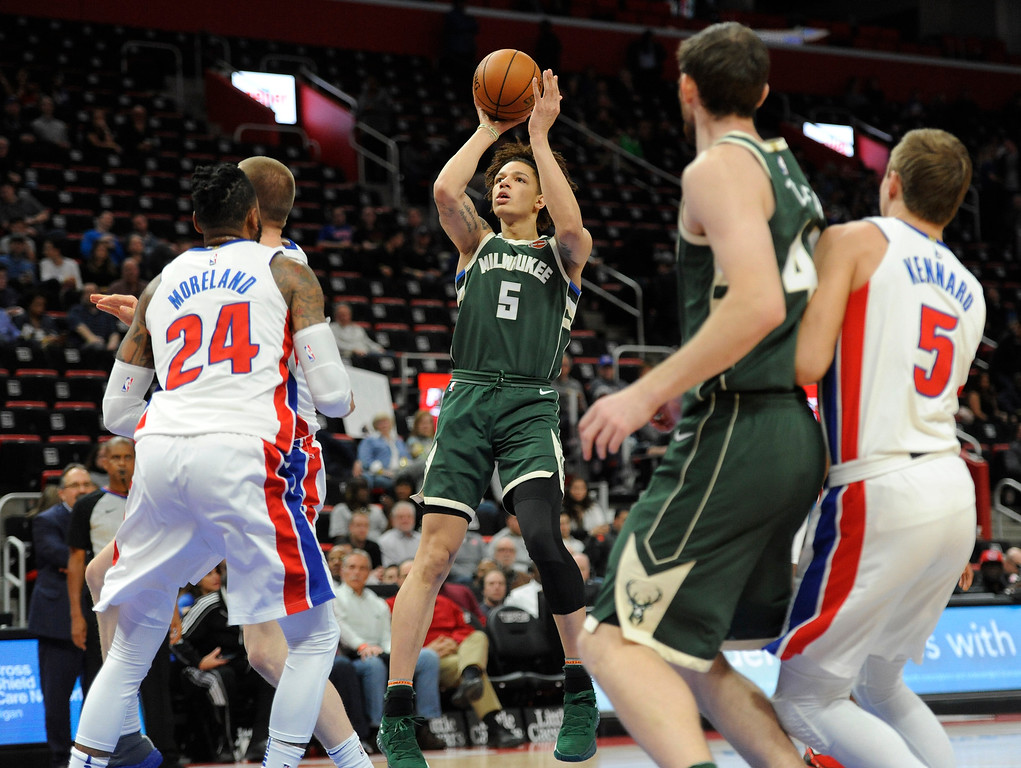 . Milwaukee Bucks forward D.J. Wilson (5) puts up a shot against the Detroit Pistons in the second half of an NBA basketball game, Wednesday, Feb. 28, 2018 at Little Caesars Arena in Detroit.  The Pistons defeated the Bucks, 110-87.  Wilson is a former player at the University of Michigan.  (Special to The Oakland Press/Jose Juarez)