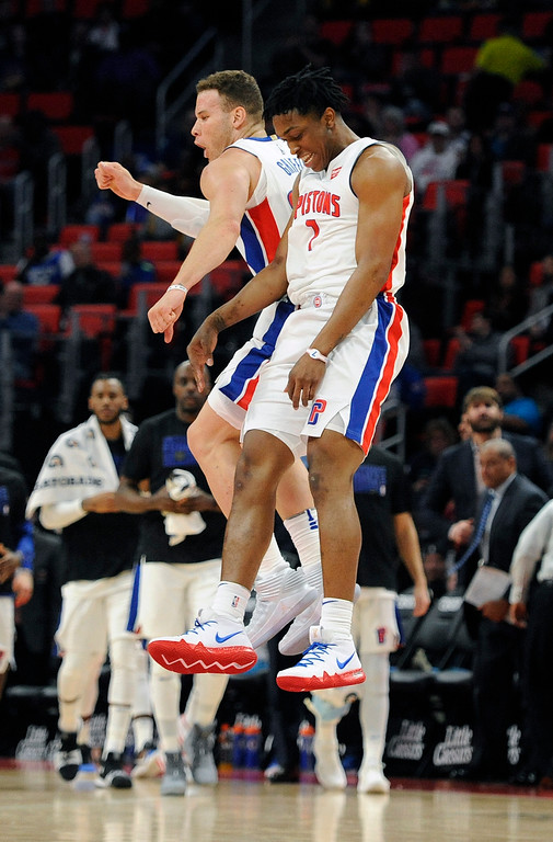 . After increasing the team lead, Detroit Pistons forward Stanley Johnson (7) is congratulated by teammate Blake Griffin in the second half of an NBA basketball game against the Milwaukee Bucks, Wednesday, Feb. 28, 2018 at Little Caesars Arena in Detroit.  The Pistons defeated the Bucks, 110-87.  (Special to The Oakland Press/Jose Juarez)