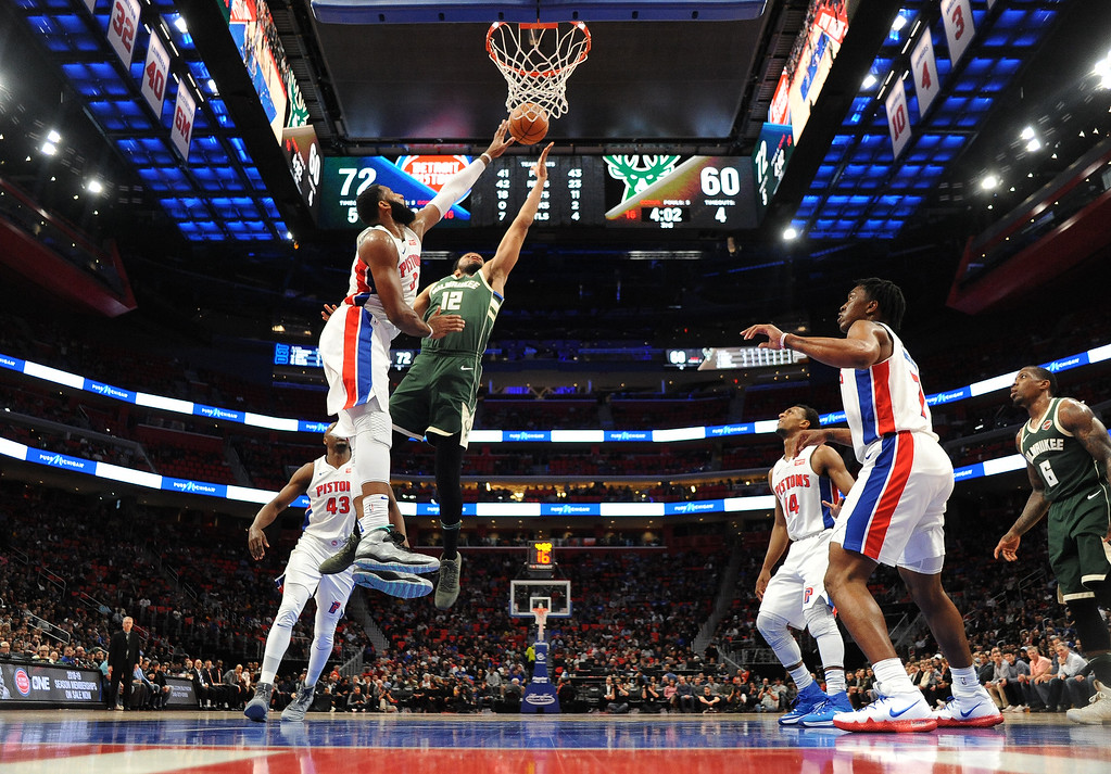 . Detroit Pistons center Andre Drummond (0) blocks the shot of Milwaukee Bucks forward Jabari Parker (12) in the third quarter of an NBA basketball game, Wednesday, Feb. 28, 2018 at Little Caesars Arena in Detroit.  The Pistons defeated the Bucks, 110-87.  (Special to The Oakland Press/Jose Juarez)