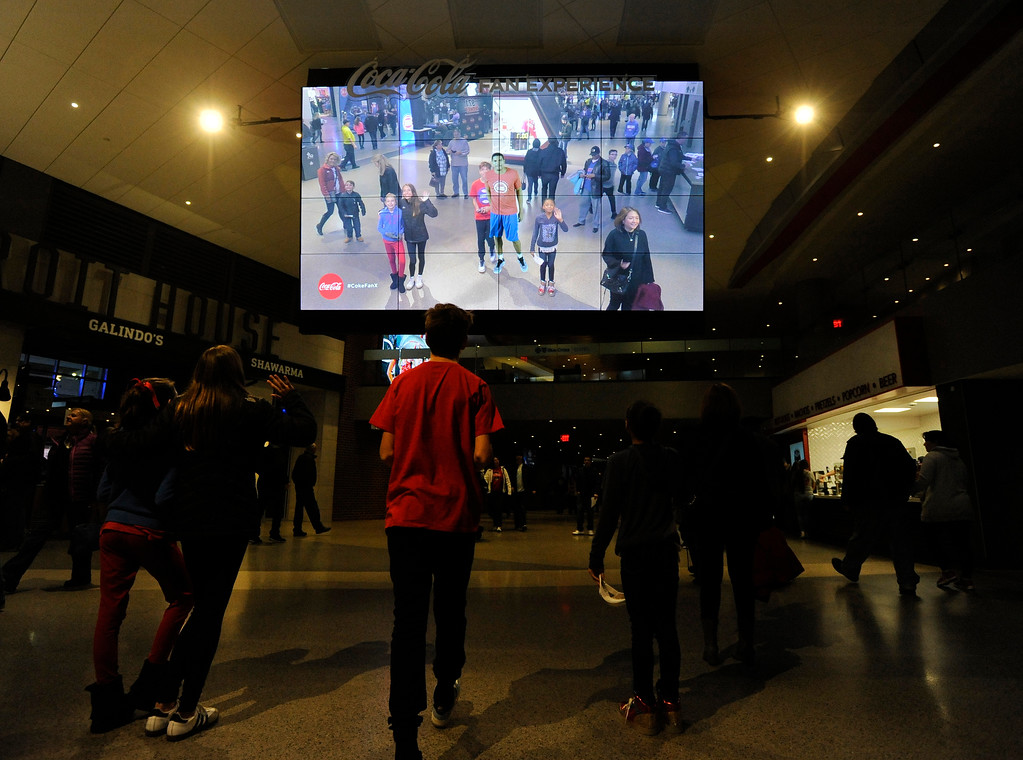 . Fans stop to look at a video board which not only shows them but also an overlay of a Detroit Pistons player that appears on motion activation in this area of Little Caesars Arena.  Photo taken on Saturday, Nov. 4, 2017 in Detroit.  (Special to The Oakland Press/Jose Juarez)