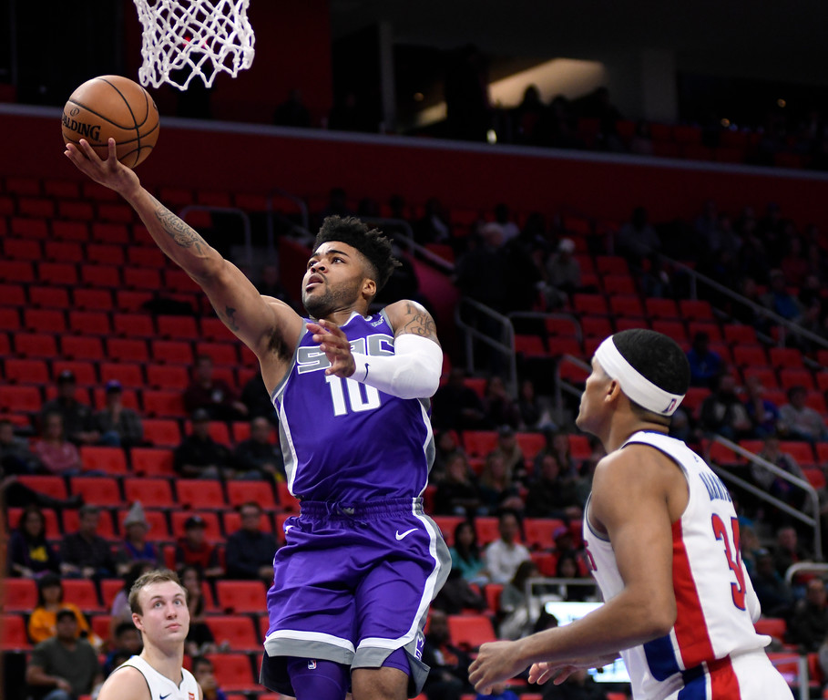 . Sacramento Kings guard Frank Mason III (10) goes in for a basket past Detroit Pistons forward Tobias Harris (34) in the fourth quarter, Saturday, Nov. 4, 2017 in Detroit.  The Pistons defeated the Kings 108-99.  (Special to The Oakland Press/Jose Juarez)