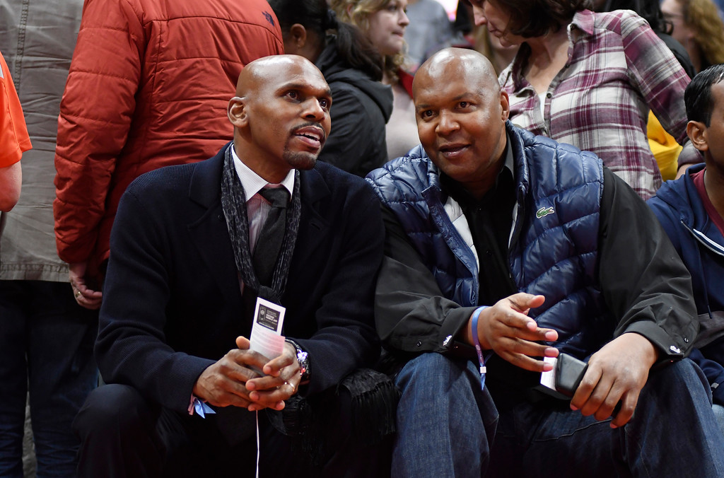 . Former Detroit Pistons players Jerry Stackhouse, left, and Derrick Coleman watch the Pistons play the Sacramento Kings, Saturday, Nov. 4, 2017 in Detroit.  (Special to The Oakland Press/Jose Juarez)