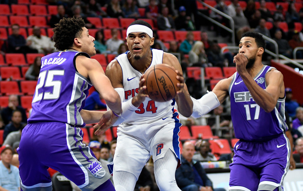 . Detroit Pistons forward Tobias Harris (34) goes for a basket as he is guarded by Sacramento Kings forward Justin Jackson (25) and guard Garrett Temple (17) during the first quarter, Saturday, Nov. 4, 2017 in Detroit.  (Special to The Oakland Press/Jose Juarez)