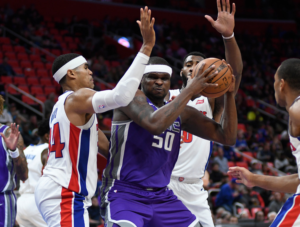 . Sacramento Kings center Zach Randolph (50) tries to go in between Detroit Pistons forward Tobias Harris (34) and center Andre Drummond (0) during the third quarter, Saturday, Nov. 4, 2017 in Detroit.  The Pistons defeated the Kings 108-99.  (Special to The Oakland Press/Jose Juarez)
