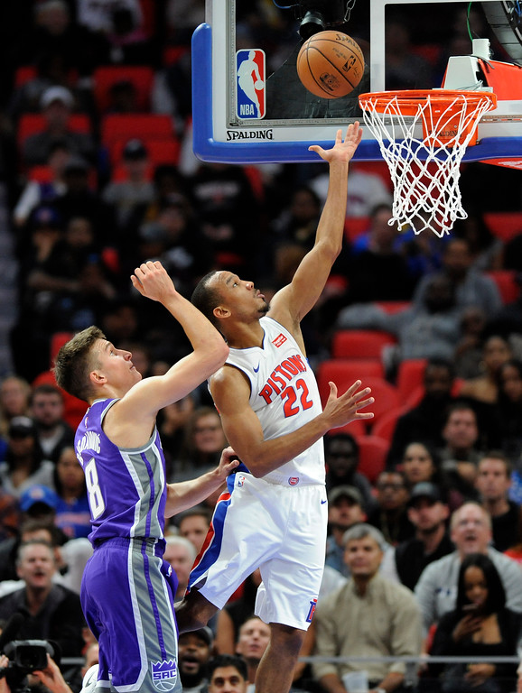 . Detroit Pistons guard Avery Bradley (22) goes past Sacramento Kings guard Bogdan Bogdanovic (8) for a layup in the third quarter, Saturday, Nov. 4, 2017 in Detroit.  The Pistons defeated the Kings 108-99.  (Special to The Oakland Press/Jose Juarez)