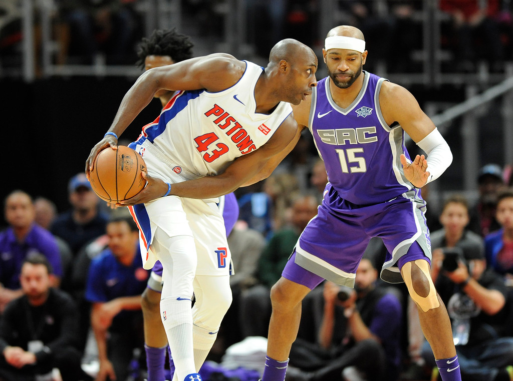. Detroit Pistons forward Anthony Tolliver (43) looks to pass around Sacramento Kings guard Vince Carter (15) in the third quarter, Saturday, Nov. 4, 2017 in Detroit.  The Pistons defeated the Kings 108-99.  (Special to The Oakland Press/Jose Juarez)