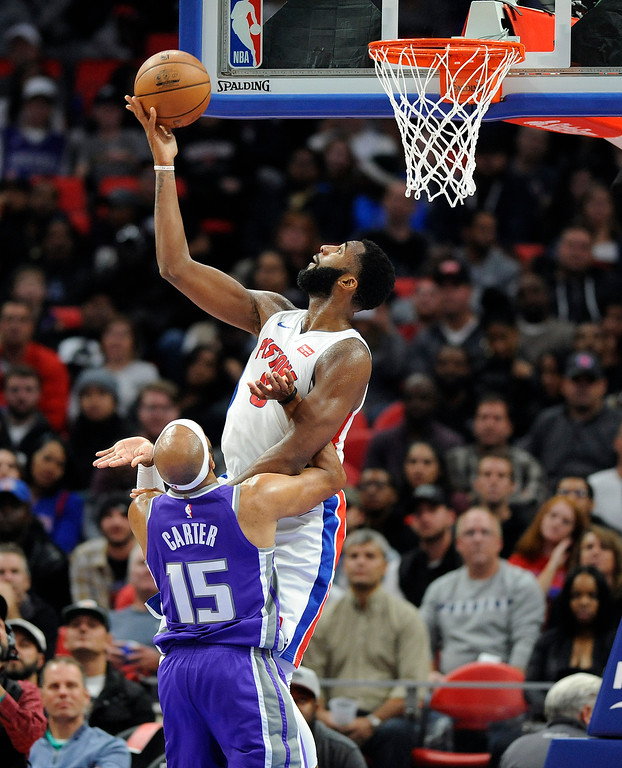 . Detroit Pistons center Andre Drummond (0) goes in reverse to tap in a lob past Sacramento Kings guard Vince Carter (15) in the fourth quarter, Saturday, Nov. 4, 2017 in Detroit.  The basket was called off.  The Pistons defeated the Kings 108-99.  (Special to The Oakland Press/Jose Juarez)