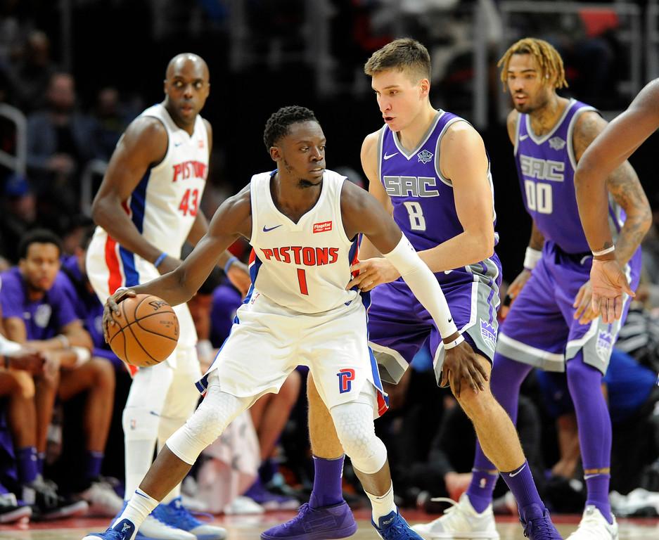 . Detroit Pistons guard Reggie Jackson (1) looks to drive past Sacramento Kings guard Bogdan Bogdanovic (8) in the fourth quarter, Saturday, Nov. 4, 2017 in Detroit.  The Pistons defeated the Kings 108-99.  (Special to The Oakland Press/Jose Juarez)