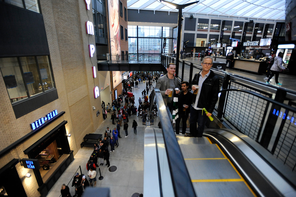 . Fans take the escalator up to the second level to head to their seats at Little Caesars Arena.  Photo taken on Saturday, Nov. 4, 2017 in Detroit.  (Special to The Oakland Press/Jose Juarez)