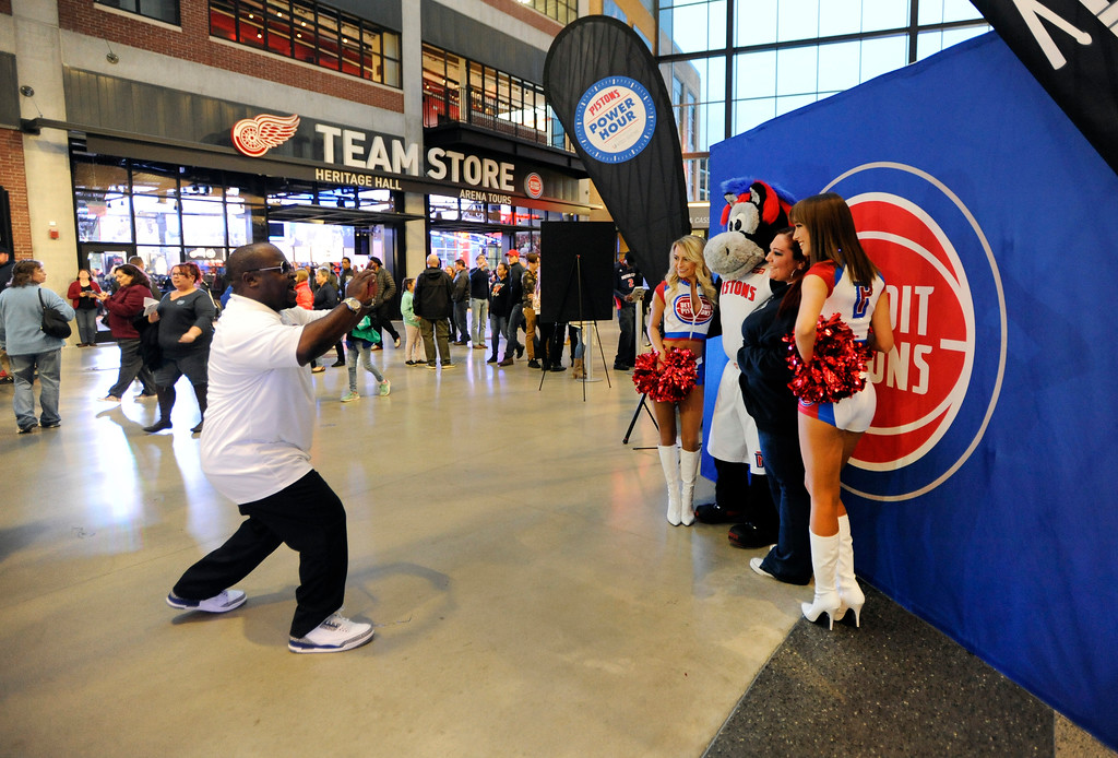 . Fans pose for photos with the Detroit Pistons dancers at Little Caesars Arena.  Photo taken on Saturday, Nov. 4, 2017 in Detroit.  (Special to The Oakland Press/Jose Juarez)