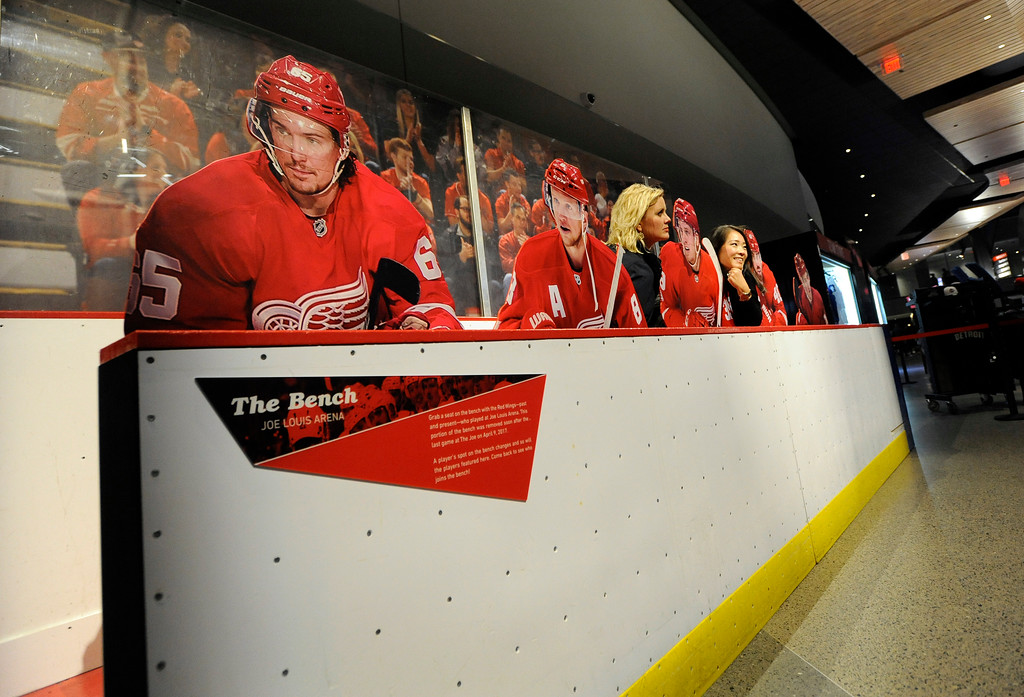 . Fans pose with cardboard cutouts of Detroit Red Wings players at Little Caesars Arena.  Photo taken on Saturday, Nov. 4, 2017 in Detroit.  (Special to The Oakland Press/Jose Juarez)