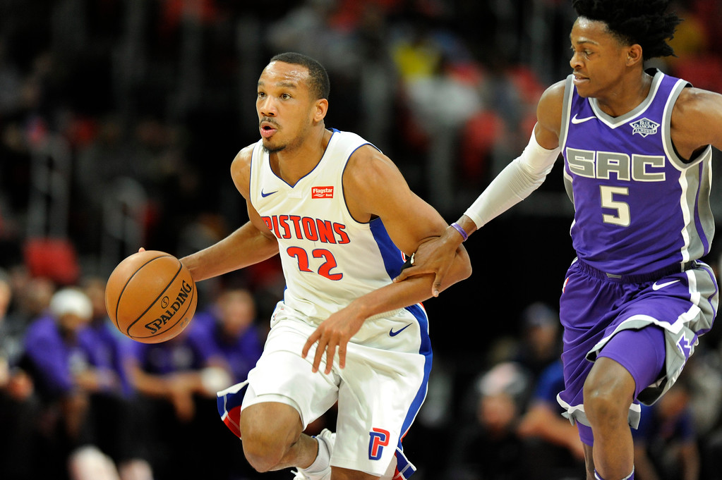 . Detroit Pistons guard Avery Bradley (22) takes the ball upcourt as he is chased by Sacramento Kings guard De\'Aaron Fox (5) during the first quarter, Saturday, Nov. 4, 2017 in Detroit.  (Special to The Oakland Press/Jose Juarez)