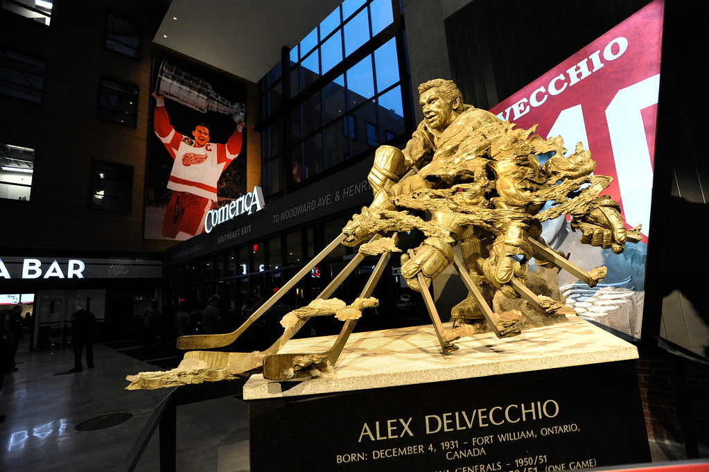 . Fans look over the statue of Detroit Red Wings Hall of Fame player Alex Delvecchio at Little Caesars Arena.  Photo taken on Saturday, Nov. 4, 2017 in Detroit.  (Special to The Oakland Press/Jose Juarez)