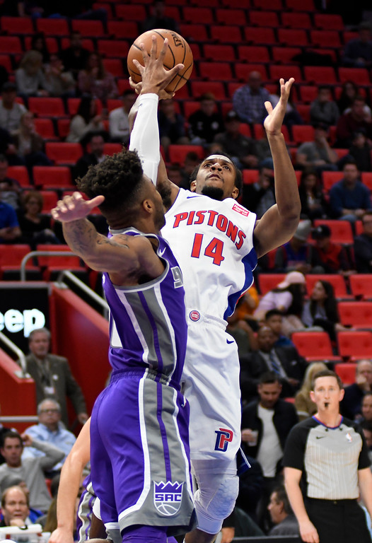 . Detroit Pistons guard Ish Smith (14) puts up a shot over Sacramento Kings guard Frank Mason III (10) during the first quarter, Saturday, Nov. 4, 2017 in Detroit.  (Special to The Oakland Press/Jose Juarez)