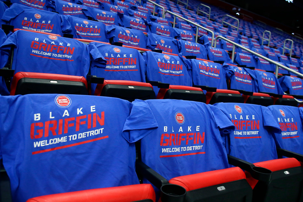 . T-Shirts welcoming Detroit Pistons forward Blake Griffin cover the seats at Little Caesars Arena before an NBA basketball game against the Memphis Grizzlies Thursday, Feb. 1, 2018, in Detroit. (AP Photo/Duane Burleson)