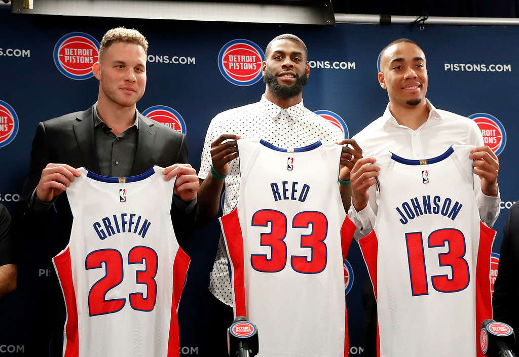 . Detroit Pistons\' Blake Griffin, from left, Willie Reed and Brice Johnson pose with their new NBA basketball uniforms in Auburn Hills, Mich., Wednesday, Jan. 31, 2018. (AP Photo/Paul Sancya)