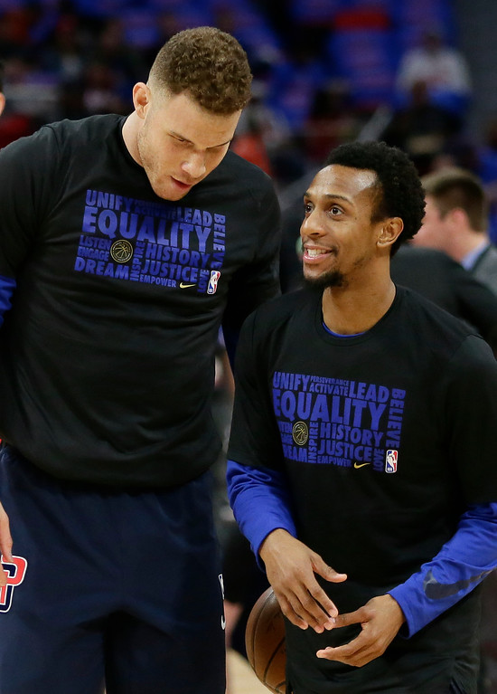 . Detroit Pistons forward Blake Griffin, left, talks with guard Ish Smith while before an NBA basketball game against the Memphis Grizzlies Thursday, Feb. 1, 2018, in Detroit. (AP Photo/Duane Burleson)
