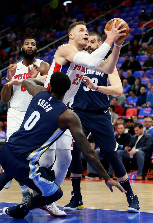 . Detroit Pistons forward Blake Griffin (23) collides with Memphis Grizzlies forward JaMychal Green (0) while going to the basket as Detroit center Andre Drummond, left, and Memphis center Marc Gasol (33) watch during the first half of an NBA basketball game Thursday, Feb. 1, 2018, in Detroit. (AP Photo/Duane Burleson)
