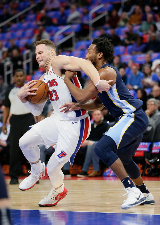 . Detroit Pistons forward Blake Griffin (23) is defended by Memphis Grizzlies guard Wayne Selden (7) while going to the basket during the first half of an NBA basketball game Thursday, Feb. 1, 2018, in Detroit. (AP Photo/Duane Burleson)