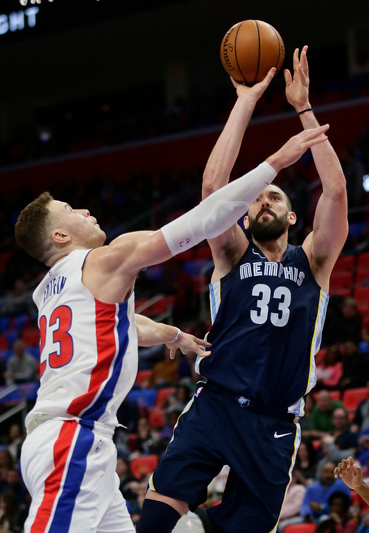 . Memphis Grizzlies center Marc Gasol (33) shoots over Detroit Pistons forward Blake Griffin (23) during the second half of an NBA basketball game Thursday, Feb. 1, 2018, in Detroit. The Pistons won 104-102. (AP Photo/Duane Burleson)