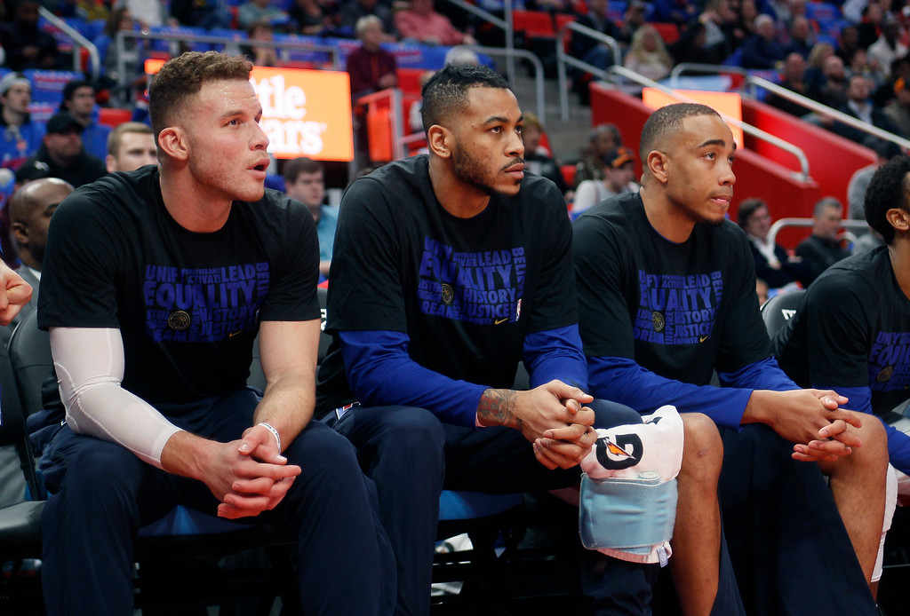. Detroit Pistons forwards Blake Griffin, from left, Eric Moreland and Brice Johnson sit on the bench during the first half of an NBA basketball game against the Memphis Grizzlies Thursday, Feb. 1, 2018, in Detroit. (AP Photo/Duane Burleson)