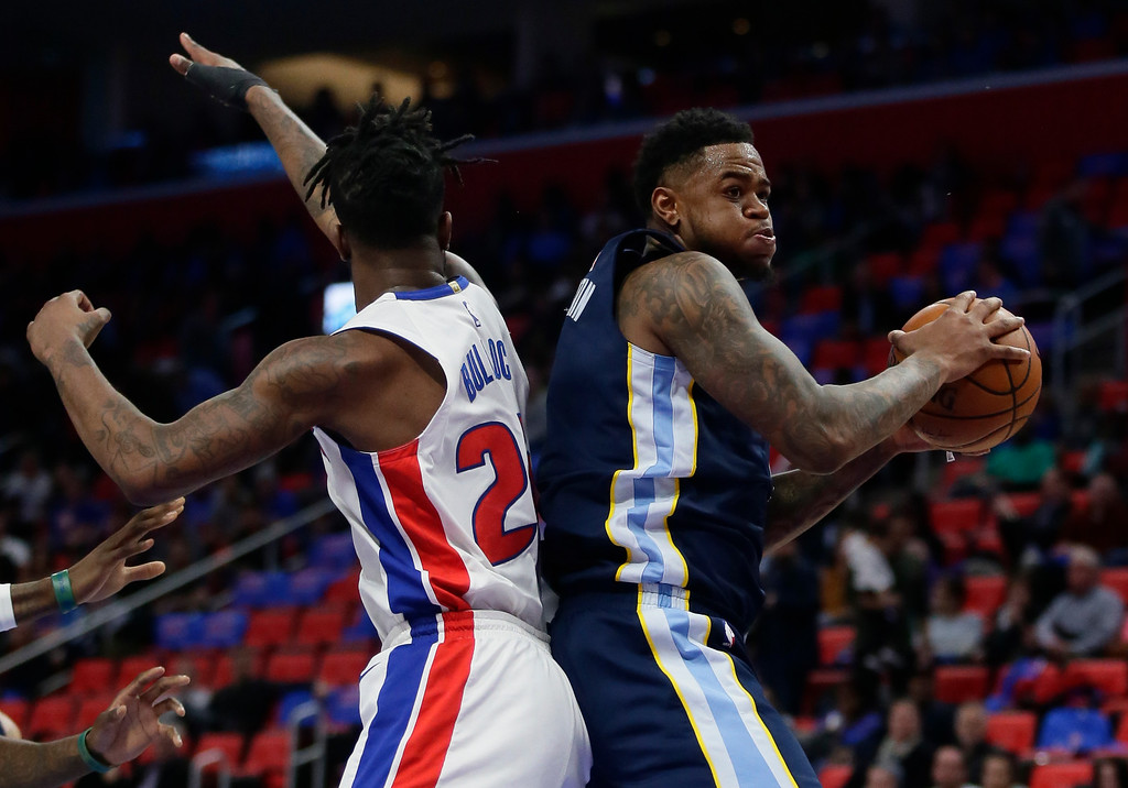 . Memphis Grizzlies forward Jarell Martin (1) grabs a rebound next Detroit Pistons forward Reggie Bullock (25) during the second half of an NBA basketball game Thursday, Feb. 1, 2018, in Detroit. The Pistons won 104-102. (AP Photo/Duane Burleson)