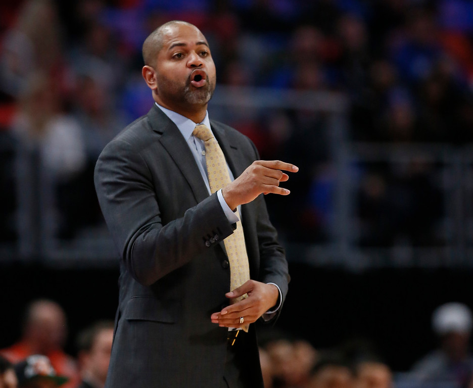 . Memphis Grizzlies head coach J.B. Bickerstaff shouts to his team during the first half of an NBA basketball game against the Detroit Pistons Thursday, Feb. 1, 2018, in Detroit. (AP Photo/Duane Burleson)