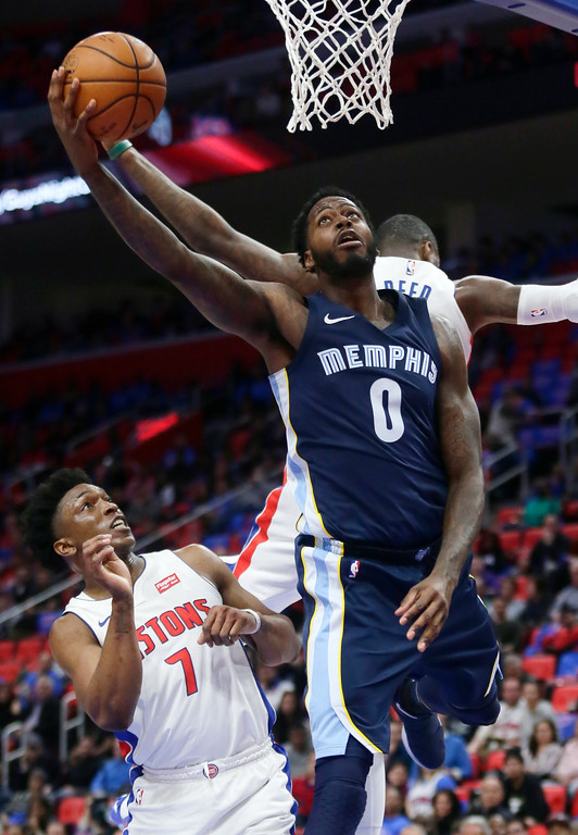 . Memphis Grizzlies forward JaMychal Green (0) goes to the basket behind Detroit Pistons center Willie Reed as Pistons forward Stanley Johnson (7) avoids the play during the second half of an NBA basketball game Thursday, Feb. 1, 2018, in Detroit. The Pistons defeated the Grizzlies 104-102. (AP Photo/Duane Burleson)