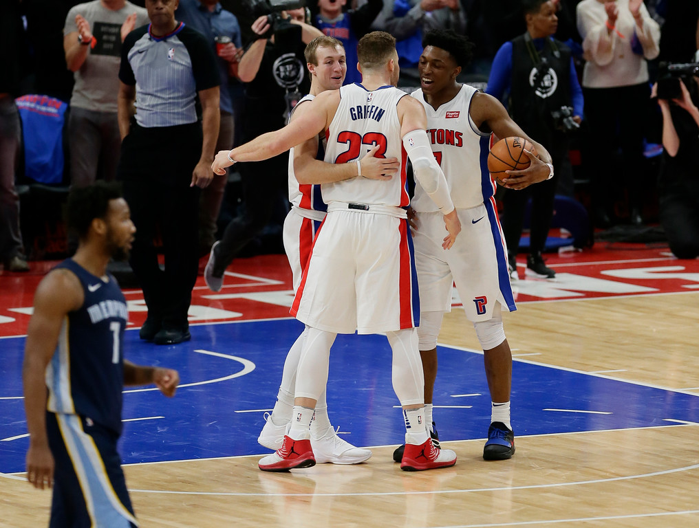 . Detroit Pistons forward Blake Griffin (23) celebrates with guard Luke Kennard, left, and forward Stanley Johnson, right, after a 104-102 win over the Memphis Grizzlies in an NBA basketball game Thursday, Feb. 1, 2018, in Detroit. (AP Photo/Duane Burleson)
