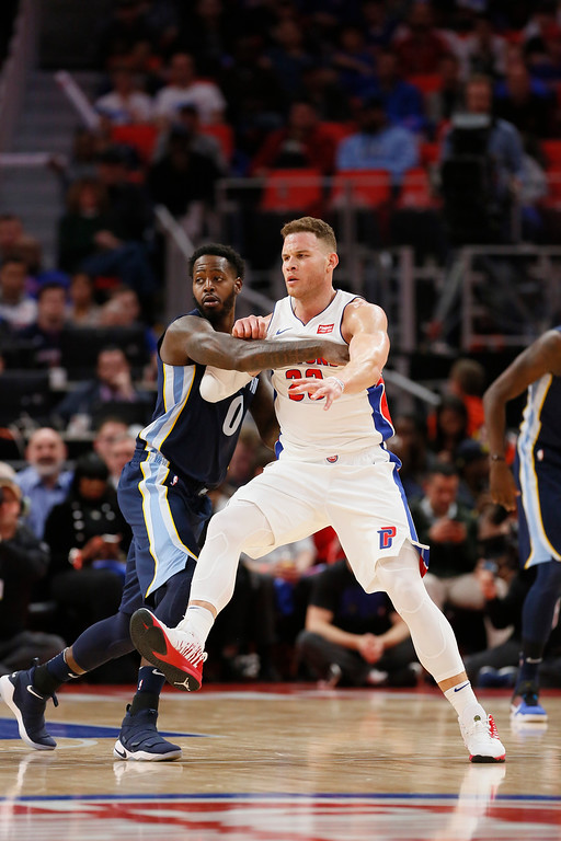 . Detroit Pistons forward Blake Griffin (23) battle for position with Memphis Grizzlies forward JaMychal Green (0) during the second half of an NBA basketball game Thursday, Feb. 1, 2018, in Detroit. The Pistons defeated the Grizzlies 104-102. (AP Photo/Duane Burleson)