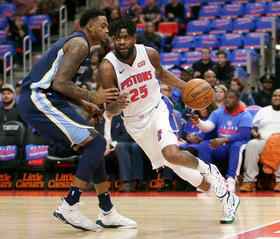 . Detroit Pistons forward Reggie Bullock (25) drives against Memphis Grizzlies forward Jarell Martin (1) during the first half of an NBA basketball game Thursday, Feb. 1, 2018, in Detroit. (AP Photo/Duane Burleson)