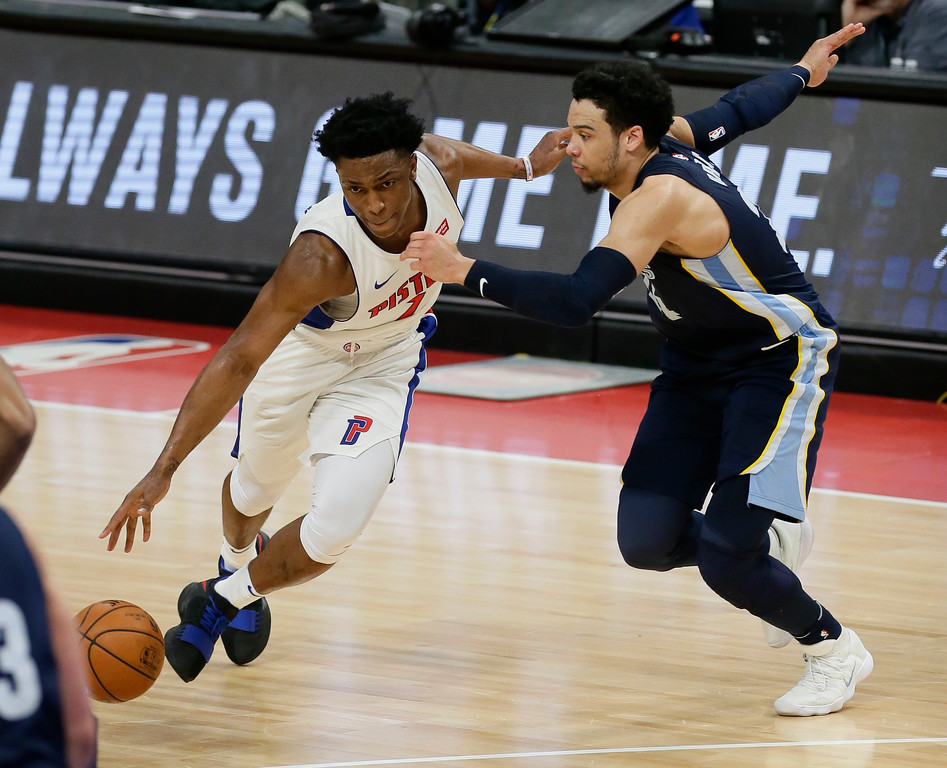 . Detroit Pistons forward Stanley Johnson (7) drives against Memphis Grizzlies forward Dillon Brooks during the second half of an NBA basketball game Thursday, Feb. 1, 2018, in Detroit. The Pistons defeated the Grizzlies 104-102. (AP Photo/Duane Burleson)