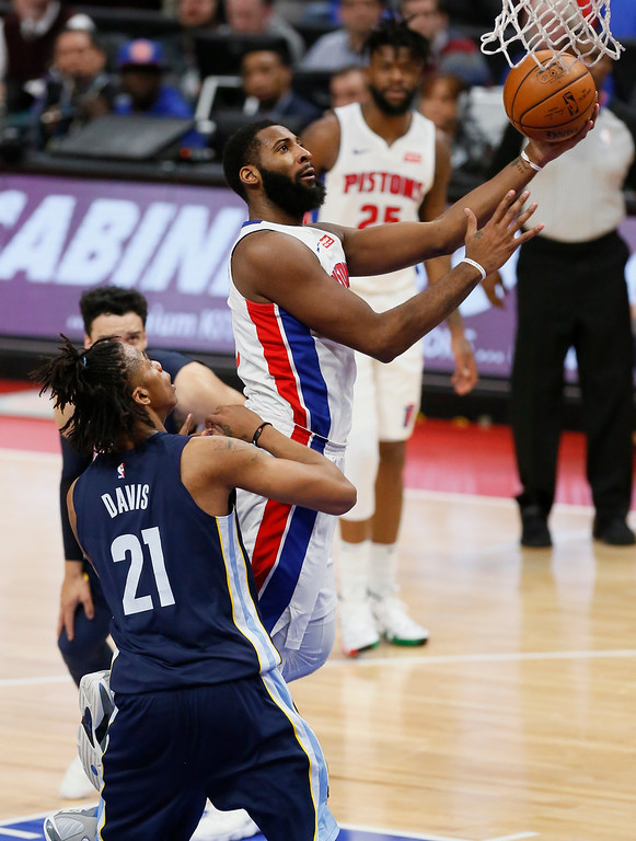 . Detroit Pistons center Andre Drummond goes to the basket past Memphis Grizzlies center Deyonta Davis (21) during the second half of an NBA basketball game Thursday, Feb. 1, 2018, in Detroit. The Pistons defeated the Grizzlies 104-102. (AP Photo/Duane Burleson)