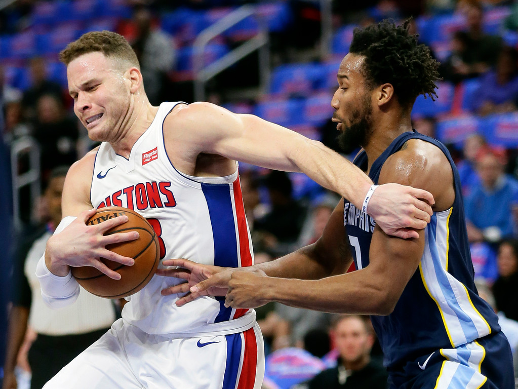 . Detroit Pistons forward Blake Griffin (23) is defended by Memphis Grizzlies guard Wayne Selden while going to the basket during the first half of an NBA basketball game Thursday, Feb. 1, 2018, in Detroit. (AP Photo/Duane Burleson)