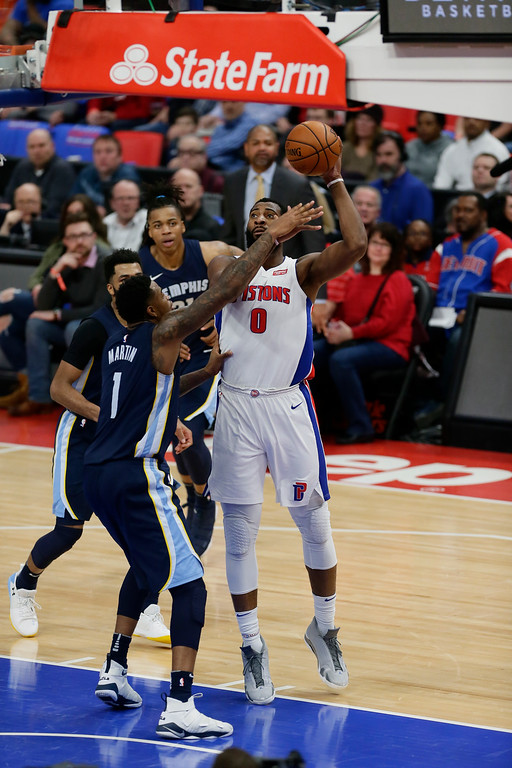 . Detroit Pistons center Andre Drummond (0) takes a shot against Memphis Grizzlies forward Jarell Martin (1) during the second half of an NBA basketball game Thursday, Feb. 1, 2018, in Detroit. The Pistons defeated the Grizzlies 104-102. (AP Photo/Duane Burleson)