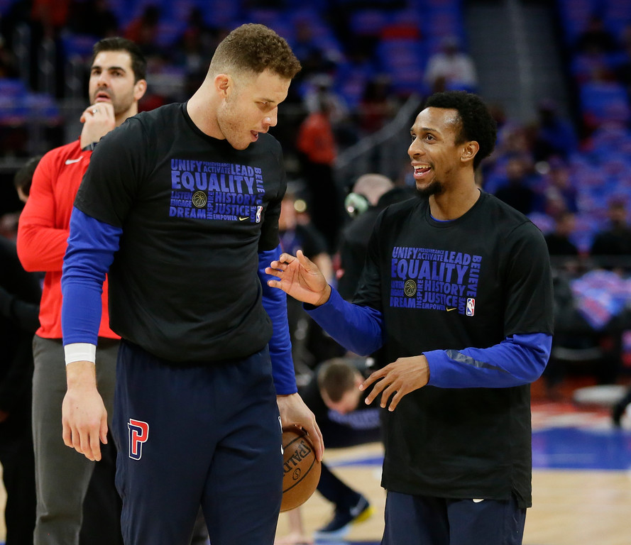 . Detroit Pistons forward Blake Griffin (23) talks with guard Ish Smith (14) while warming up for an NBA basketball game against the Memphis Grizzlies Thursday, Feb. 1, 2018, in Detroit. (AP Photo/Duane Burleson)