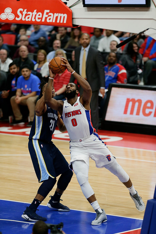 . Detroit Pistons center Andre Drummond (0) takes a shot against Memphis Grizzlies center Deyonta Davis (21) during the second half of an NBA basketball game Thursday, Feb. 1, 2018, in Detroit. The Pistons defeated the Grizzlies 104-102. (AP Photo/Duane Burleson)