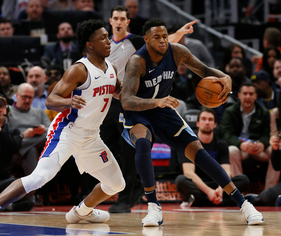 . Memphis Grizzlies forward Jarell Martin (1) drives against Detroit Pistons forward Stanley Johnson (7) during the first half of an NBA basketball game Thursday, Feb. 1, 2018, in Detroit. (AP Photo/Duane Burleson)