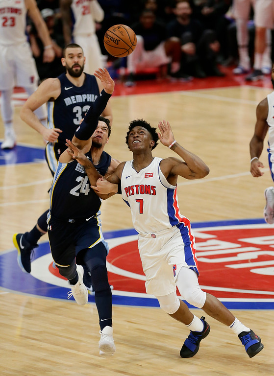 . Memphis Grizzlies forward Dillon Brooks (24) grabs the arm of Detroit Pistons forward Stanley Johnson (7) as they chases a loose ball during the second half of an NBA basketball game Thursday, Feb. 1, 2018, in Detroit. The Pistons defeated the Grizzlies 104-102. (AP Photo/Duane Burleson)