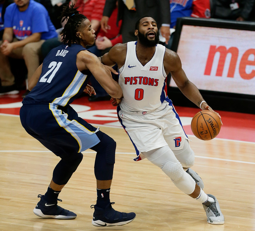 . Detroit Pistons center Andre Drummond (0) drives to the basket against Memphis Grizzlies center Deyonta Davis (21) during the second half of an NBA basketball game Thursday, Feb. 1, 2018, in Detroit. The Pistons defeated the Grizzlies 104-102. (AP Photo/Duane Burleson)