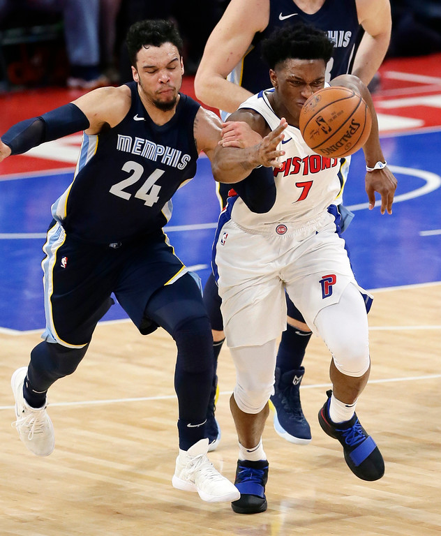 . Memphis Grizzlies forward Dillon Brooks (24) grabs the arm of Detroit Pistons forward Stanley Johnson (7) as they chase the ball during the second half of an NBA basketball game Thursday, Feb. 1, 2018, in Detroit. The Pistons defeated the Grizzlies 104-102. (AP Photo/Duane Burleson)