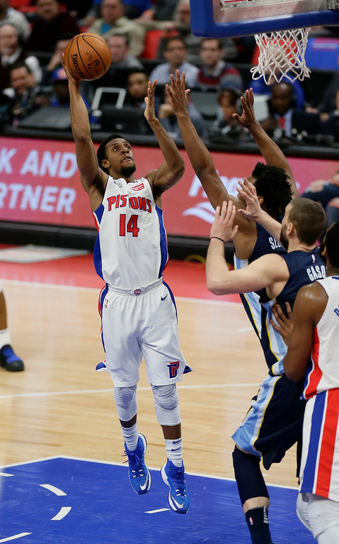 . Detroit Pistons guard Ish Smith (14) takes a shit against the Memphis Grizzlies during the second half of an NBA basketball game Thursday, Feb. 1, 2018, in Detroit. The Pistons defeated the Grizzlies 104-102. (AP Photo/Duane Burleson)