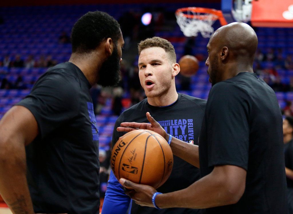. Detroit Pistons forward Blake Griffin, center, talks with center Andre Drummond, left, and forward Anthony Tolliver before the team\'s NBA basketball game against the Memphis Grizzlies on Thursday, Feb. 1, 2018, in Detroit. (AP Photo/Duane Burleson)
