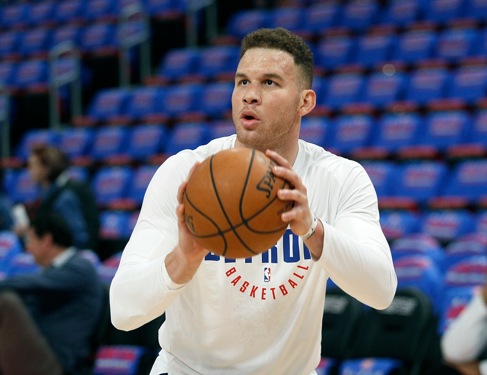 . Detroit Pistons forward Blake Griffin (23) takes a shot while warming up for a NBA basketball game against the Memphis Grizzlies Thursday, Feb. 1, 2018, in Detroit. (AP Photo/Duane Burleson)
