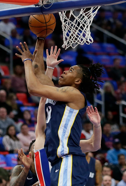 . Memphis Grizzlies center Deyonta Davis, front, takes a shot against Detroit Pistons guard Luke Kennard during the first half of an NBA basketball game Thursday, Feb. 1, 2018, in Detroit. (AP Photo/Duane Burleson)