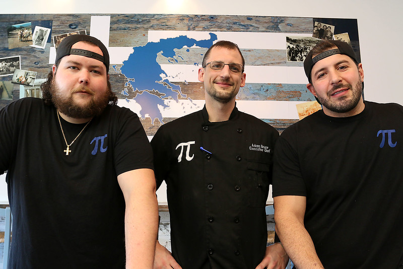 Pita Restaurant opened in the fall and has since gained quite a following for its Greek fast casual cuisine. The gyros have the French fries inside of them, just like they're made in Greece. Restaurant also does catering. Excutive Chef Adam Bruce, center stands with owners, from left, Dan Lyons and Peter Tsianakas. UN/JOHN LOVE