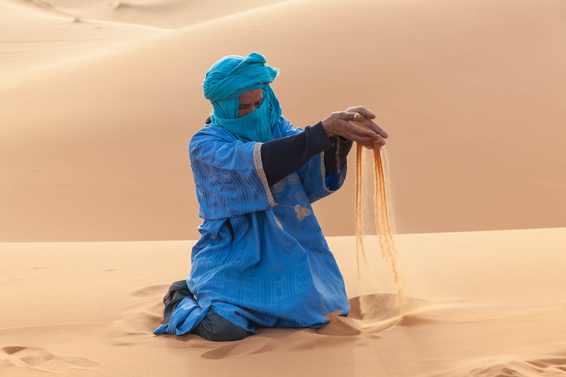 Peter's Pick - Jim Patton is frequently called an outstanding travel photographer, and his image Sifting Sand - Sahara Desert, Morocco, proves it yet again. The captivating photograph of an Arab man in colorful clothing, sifting desert sand through his hands is a striking image the viewer will enjoy studying. Jim took full advantage of this great photo opportunity and captured the image in absolutely perfect exposure and focus, something that would have been very difficult in this circumstance with soft backlight and a vast area of reflective sand that could fool a camera's light meter and a less experienced photographer. Years of traveling the world and photographing varied subjects under difficult conditions has resulted in Jim's ability to make some of the most beautiful and interesting photographs we see in our gallery. Our congratulations to Jim and our thanks for sharing his image with us.