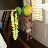 Harrison also has fun with his birthday balloons.